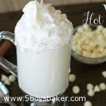 Mug of white hot chocolate with whipped cream on top.