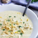 bowl of Mexican Chicken Corn Chowder with a spoon in it.