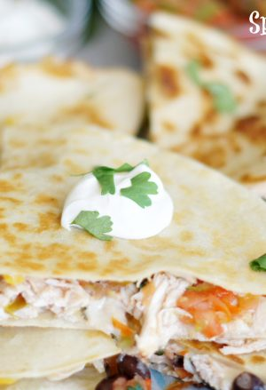 spicy chicken quesadillas stacked on top of each other