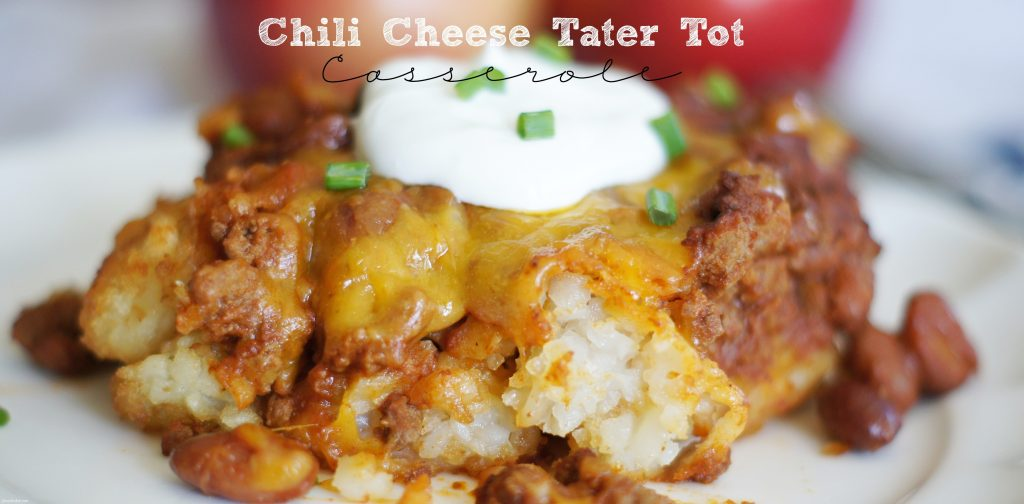 plate of chili cheese tater tot casserole with sour cream on top