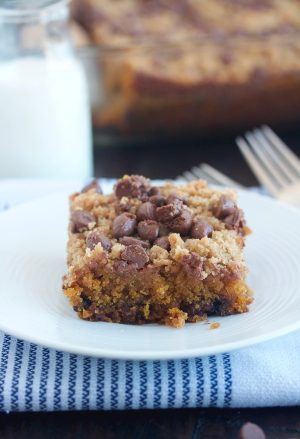piece of pumpkin chocolate chip streusel cake on a white plate