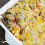 white baking dish with cheesy ground beef & rice casserole