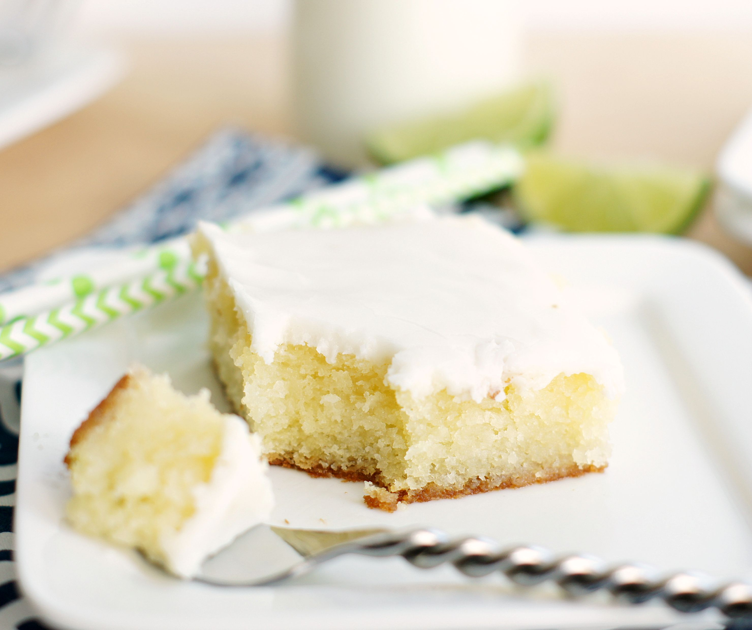 Piece of Glaze Lime Cake with a bite on a fork