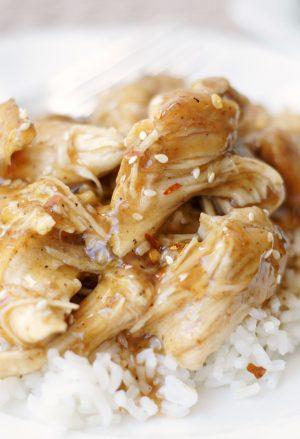 plate of slow cooker brown sugar & garlic chicken on white rice.