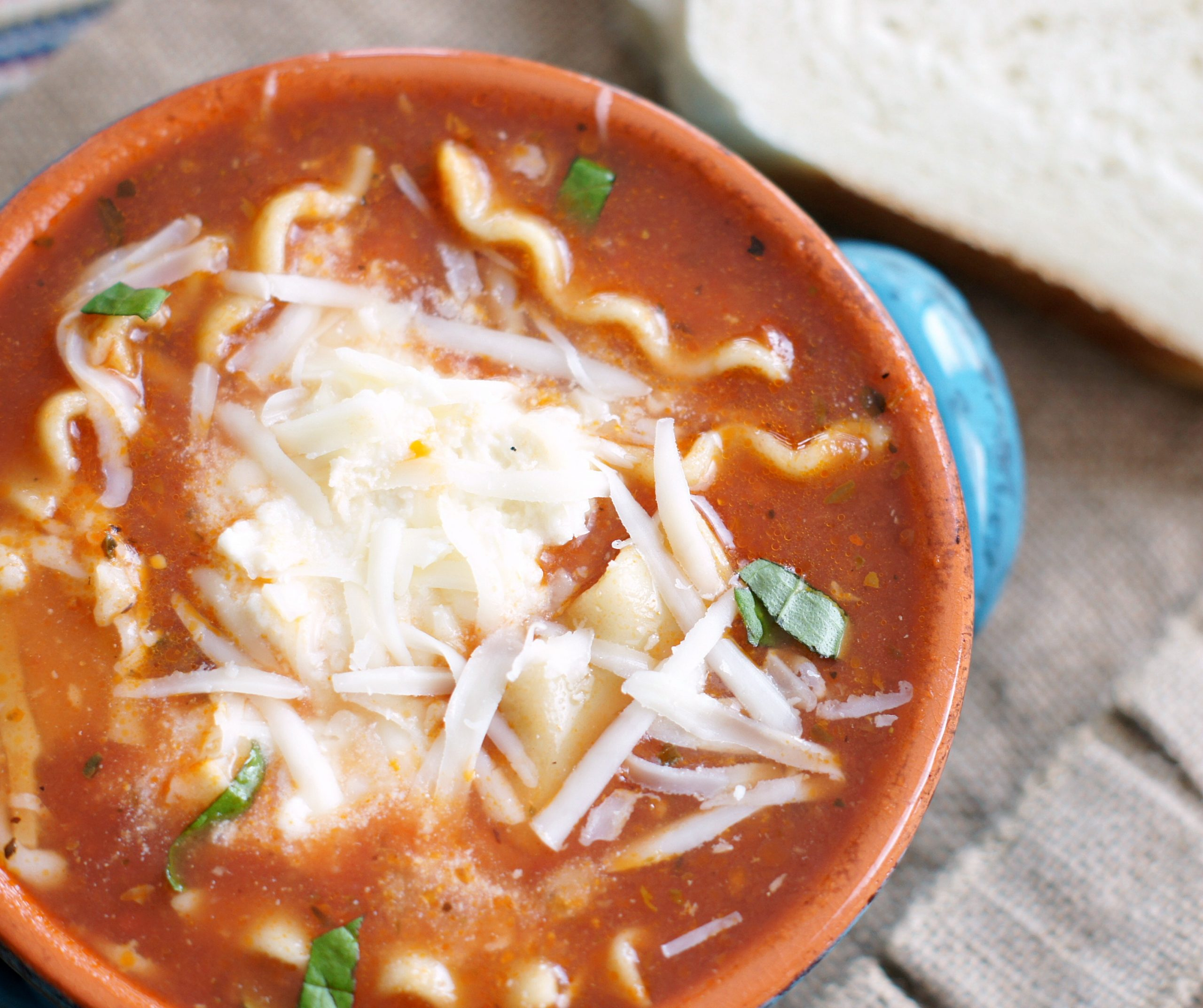 Bowl of lasagna soup with cheesy topping