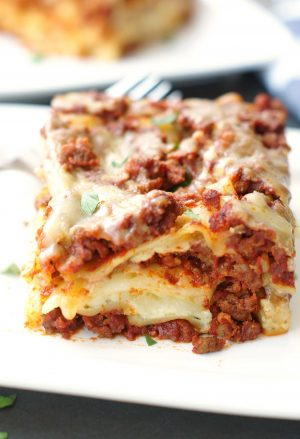 White plate with a piece of classic lasagna on it