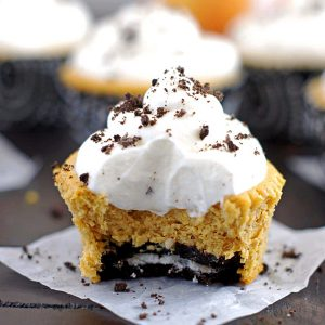 mini pumpkin Oreo cheesecake with a bite out of it