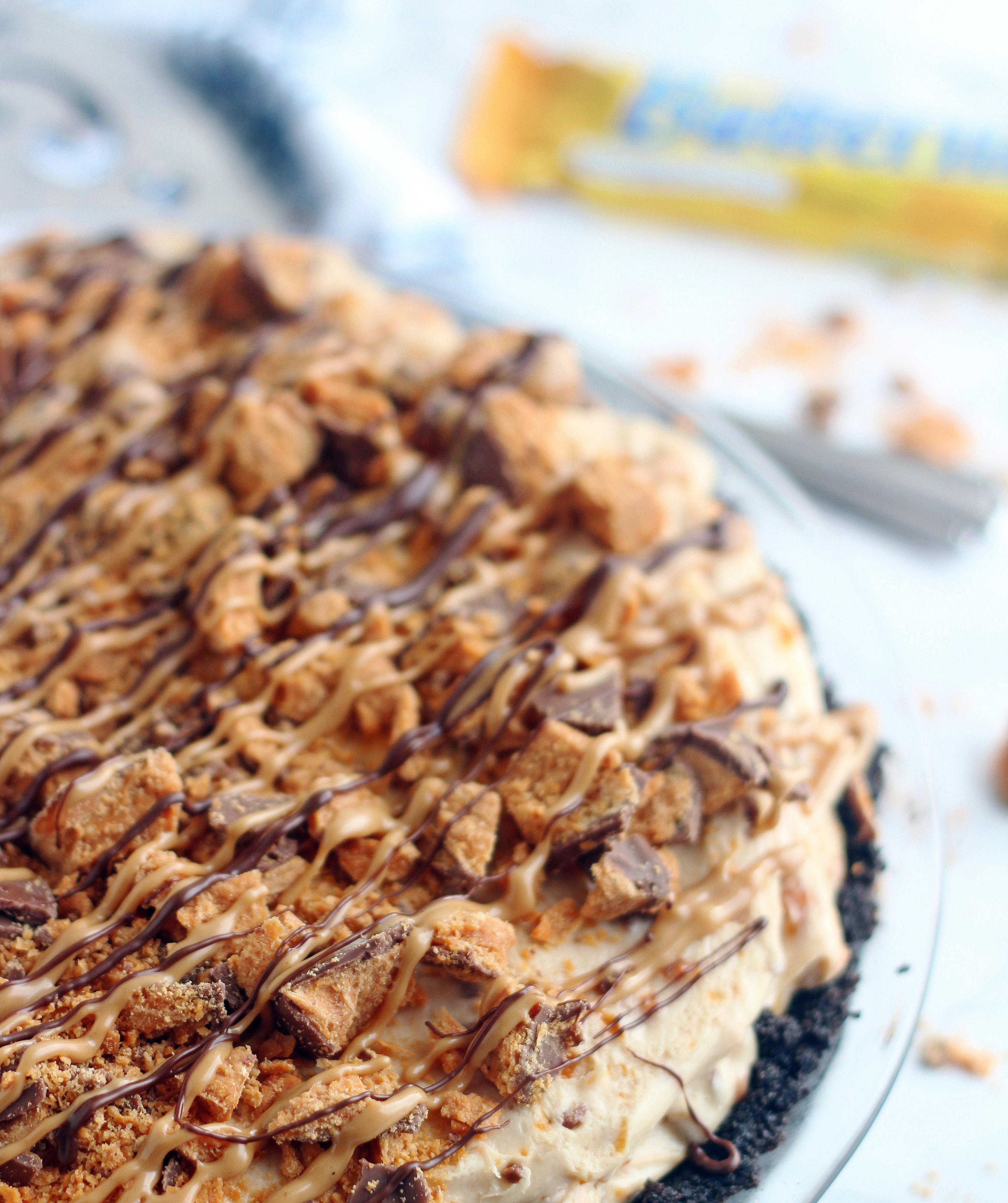 This No Bake Butterfinger Pie starts is ridiculously good! An Oreo crust, a decadent peanut butter cream cheese filling & crushed Butterfinger candy bars.