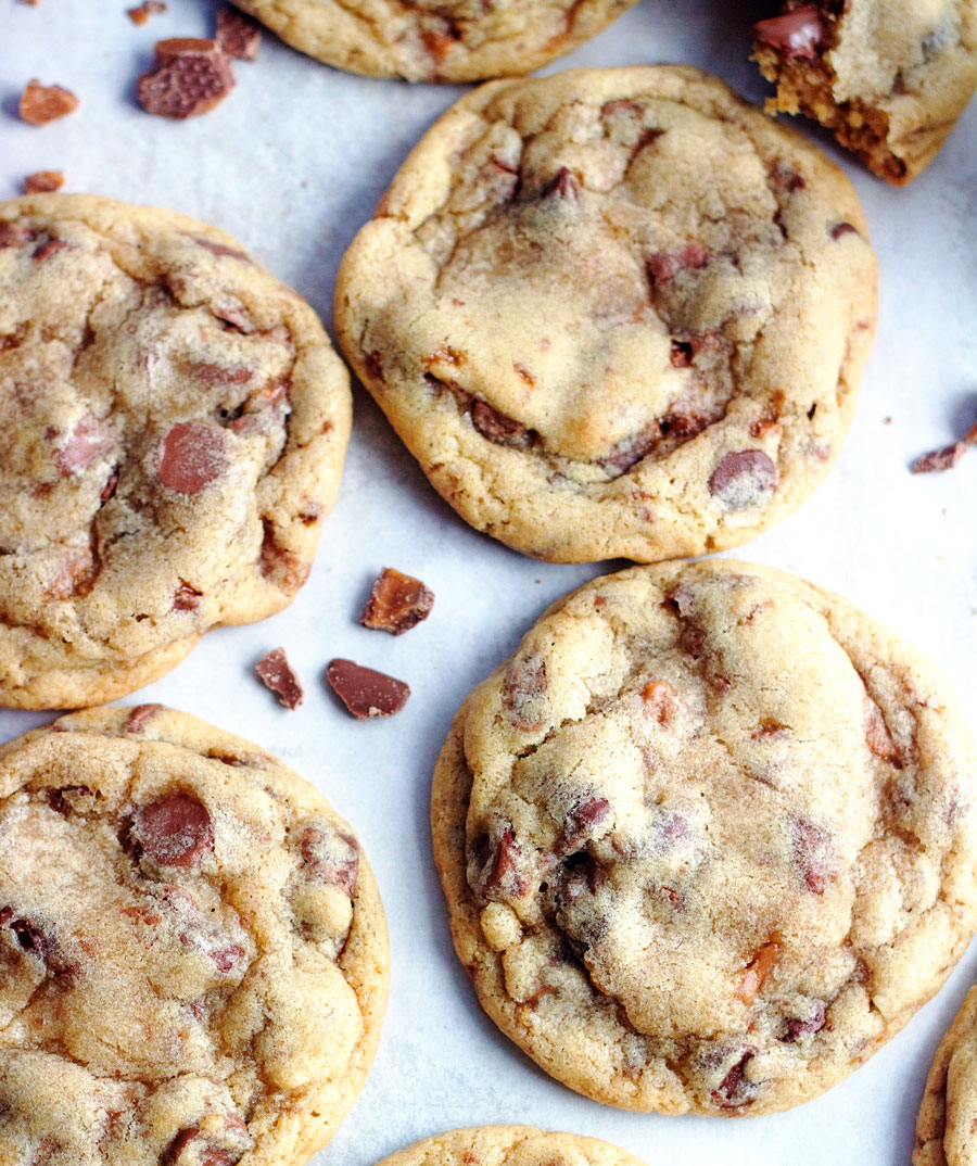 up close shot of Skor Bar Chocolate Chip Cookies laying on a cookie sheet