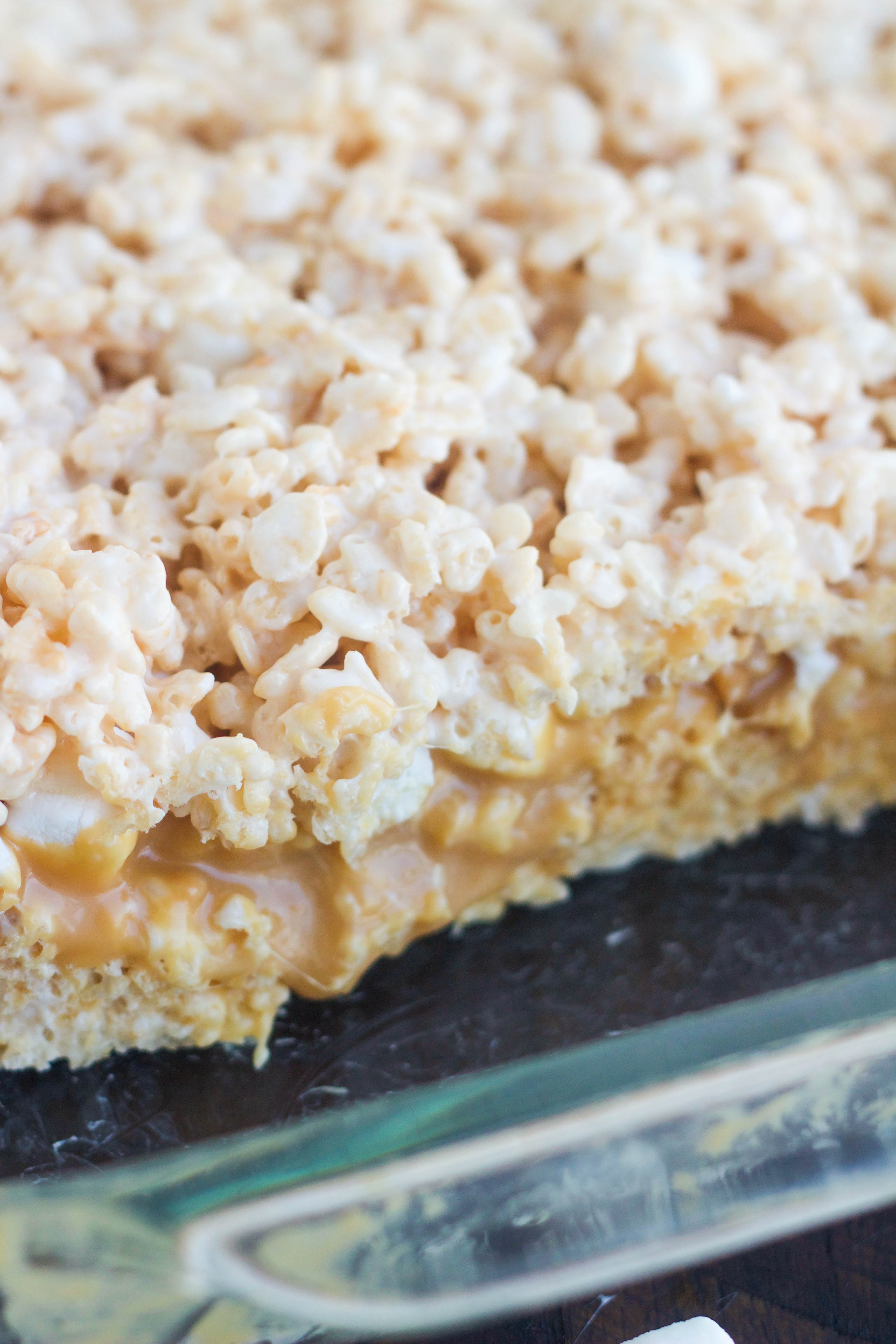 A pan of caramel stuffed Rice Krispie treats in