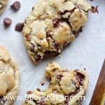 Warm pieces of copycat Levain Bakery Chocolate Chip Cookies on a cookie sheet