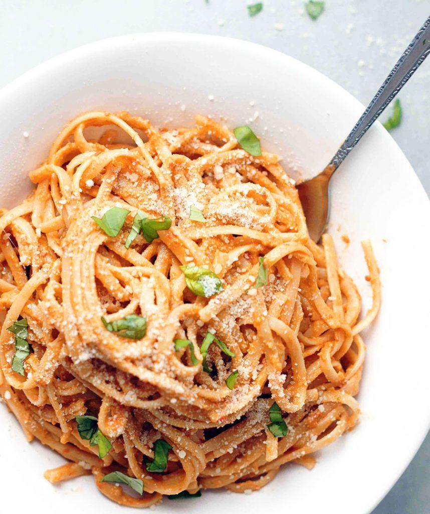 Bowl of 20-minute pasta with tomato and almond pesto