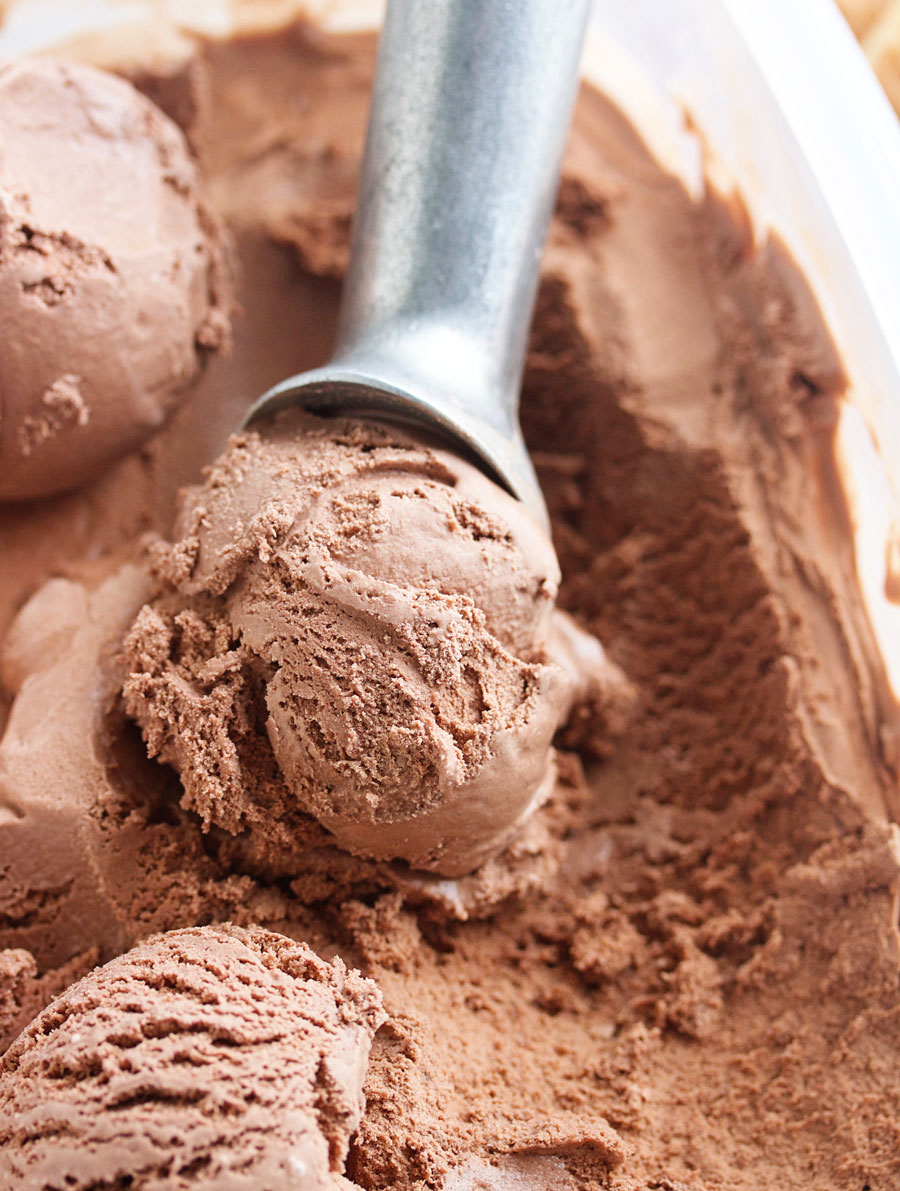 A scoop of a container of Simple and Decadent Homemade Chocolate Ice Cream