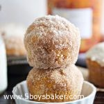 Two pumpkin donut muffins stack on top of each other