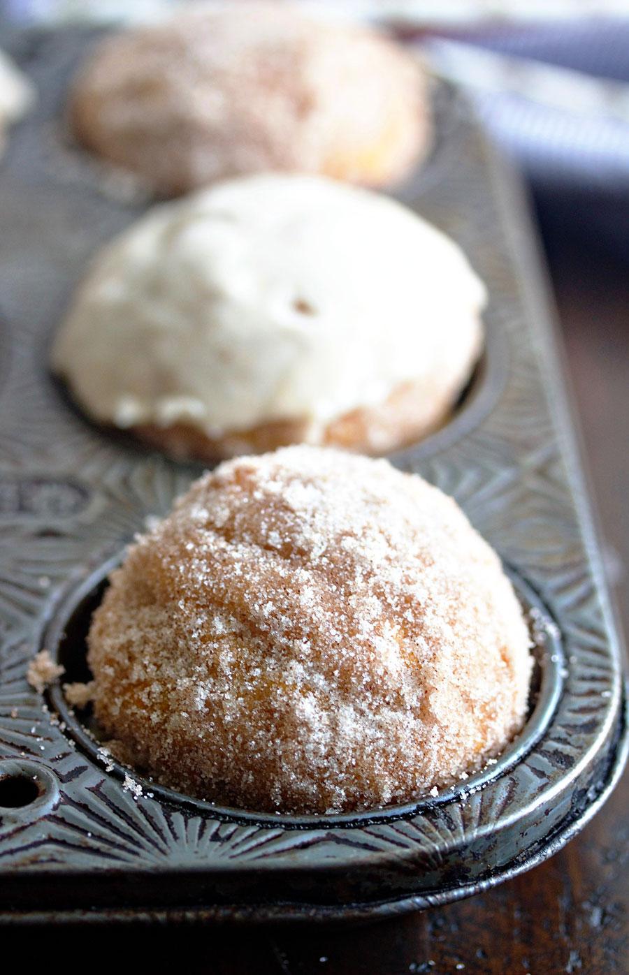 up close shot of pumpkin donut muffin in a muffin tin