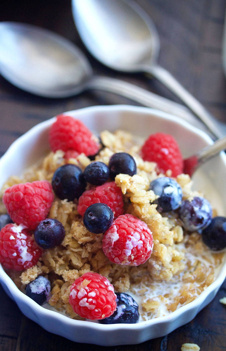up close shot of a bowl of baked oatmeal with fresh berries