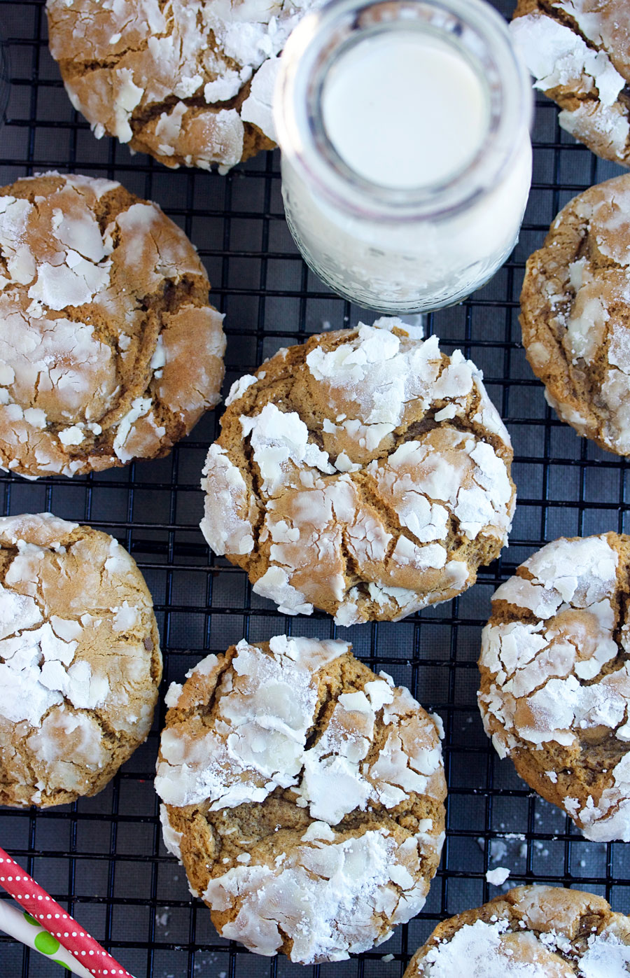 overhead shot of gingerbread crinkles with a glass of milk.