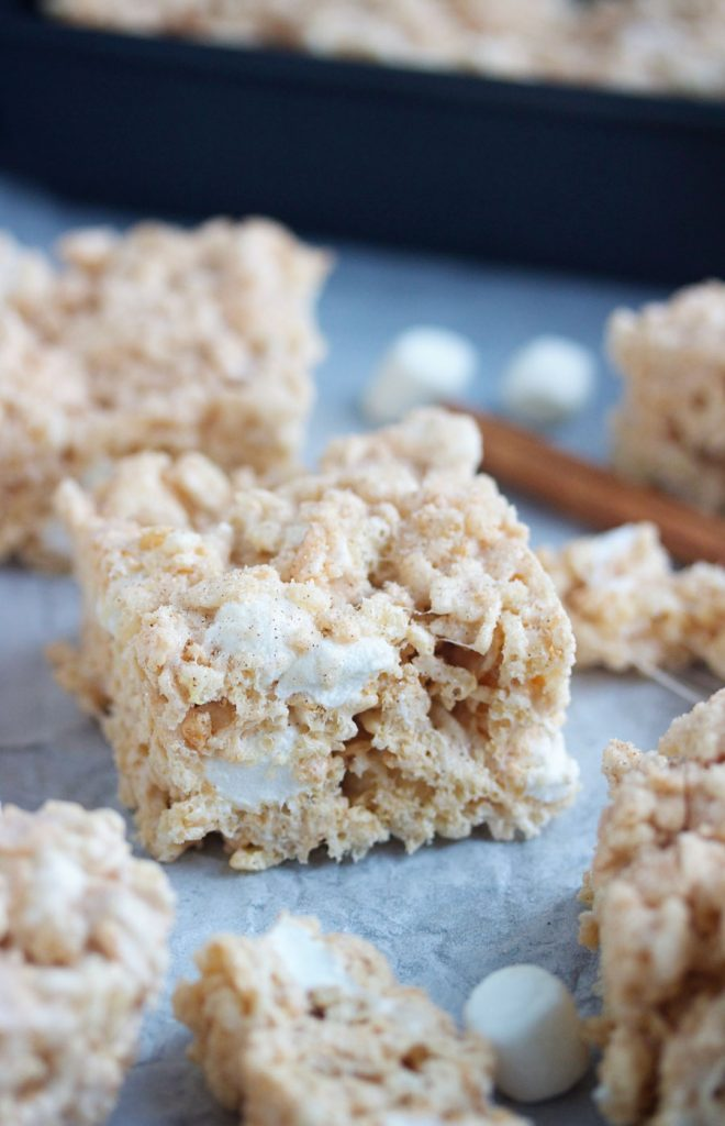 snickerdoodle rice krispie treats on parchment paper
