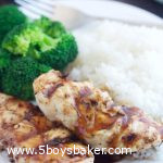 Plate of sticky coconut chicken with broccoli and coconut rice