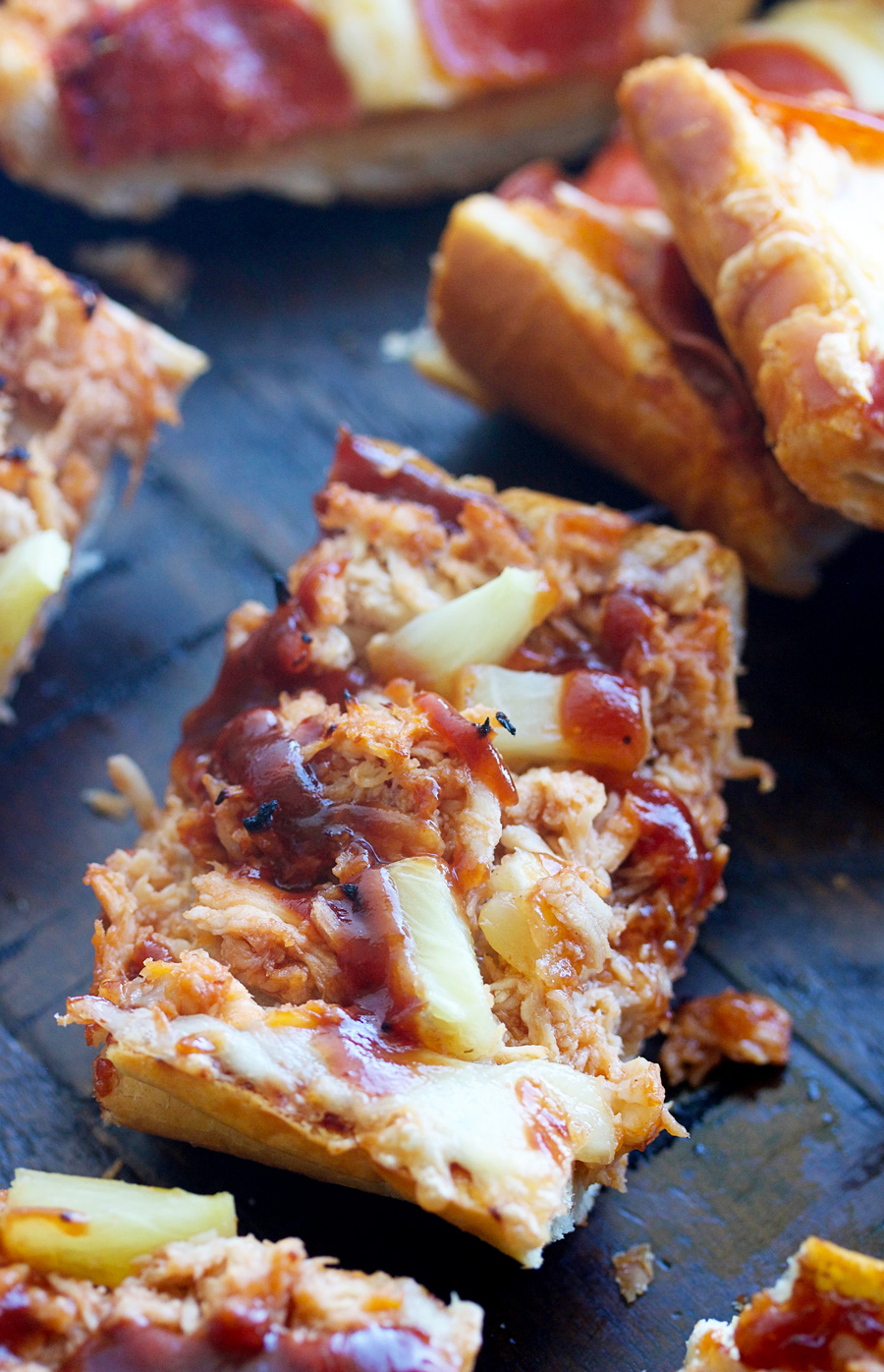 up close shot of a piece of french bread bbq chicken pizza bread