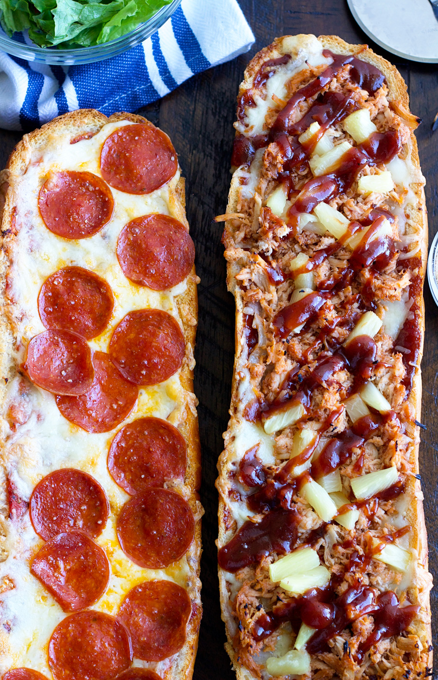 overhead shot of french bread pizza loaves one pepperoni the other one BBQ chicken