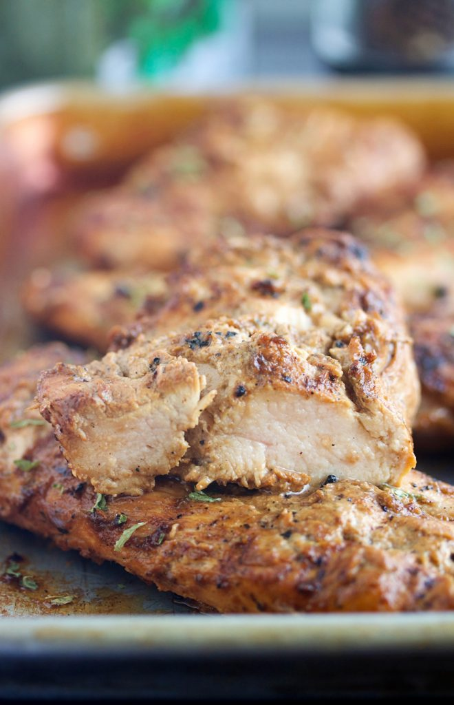 up close shot of a chicken breast marinaded in amazing chicken marinade
