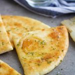 buttery garlic pita bread cut into triangles